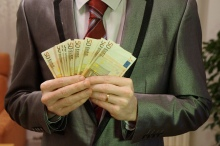 5_-_man_in_suit_holding_euro_banknotes_-_royalty_free,_without_copyright,_public_domain_photo_image